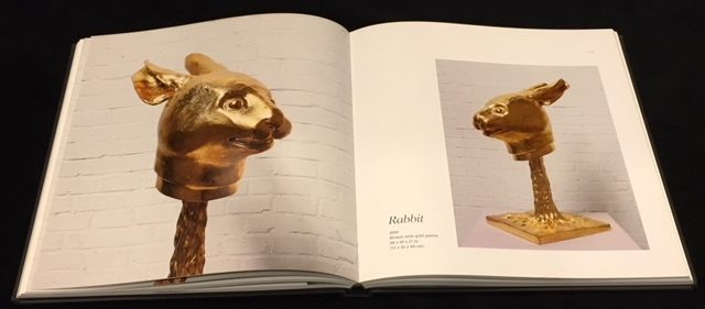 Ai Weiwei: Circle of Animals, page spread with gold fountainheads